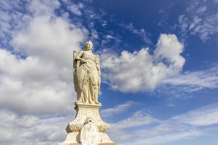 san rafael: San Rafael statue of the Roman bridge in Cordoba - Spain