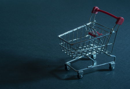 Shopping cart on blue background
