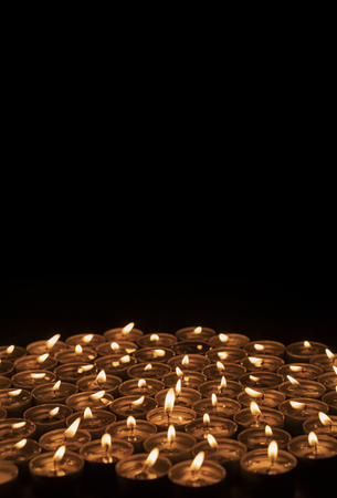 Group of candles isolated on black background