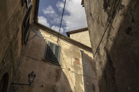 Old facades in the village Capalbio - Italy