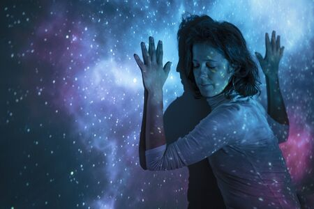 Relaxed woman feeling the universe