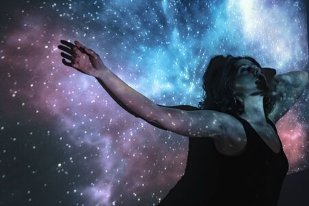 Mystical woman in the universe Stock Photo
