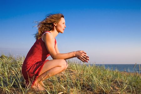 Girl sitting on a dune-4