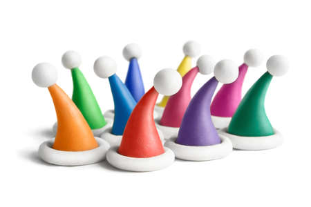 gear head: Multicolored plasticine Santa hats on a white background