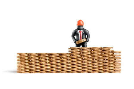 Plasticine figure of a businessman building a wall of coins Stock Photo - 11452209
