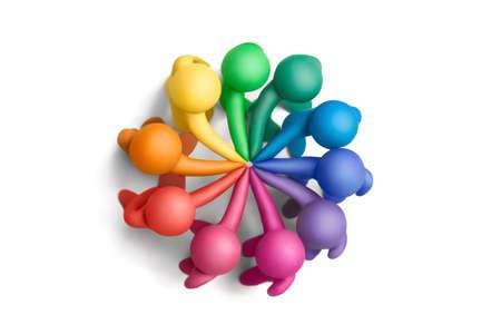 concluding: Multicolored plasticine human figures concluding a treaty