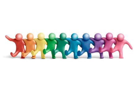 Multicolored   plasticine human dancing figures arranged in a row