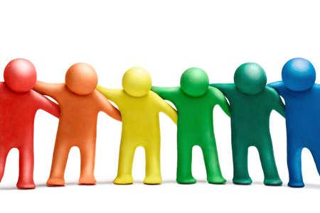 peer to peer: Multicolored  plasticine human dancing figures arranged in a row