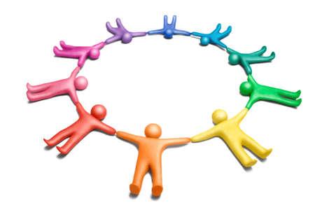Multicolored plasticine human figures organized in a circle photo