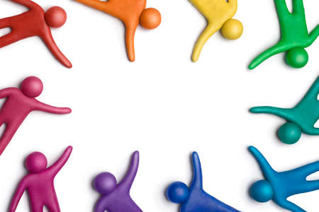 human figures: Multicolored plasticine human figures on a white background