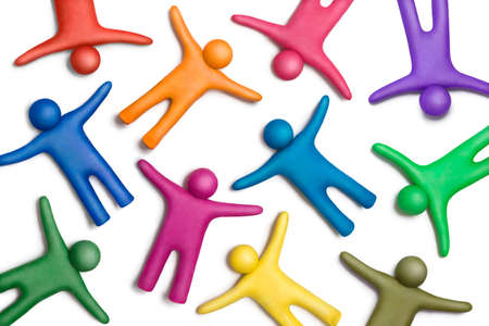 Multicolored plasticine human figures on a white background Stock Photo - 11452213