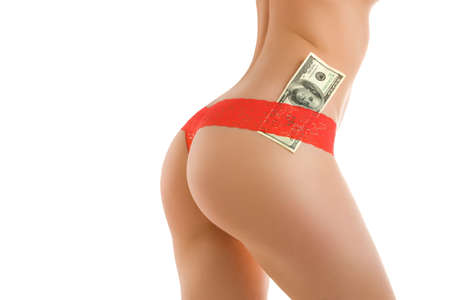 A fragment of woman  body with a 100 dollars banknote