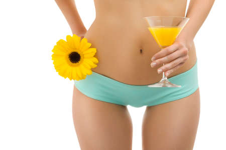 A woman with a glass of orange juice and yellow gerbera Stock Photo - 13370357