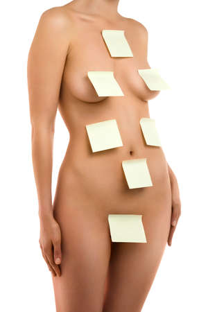 woman nude standing: A fragment of woman  body with a stick notes