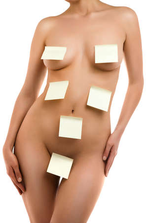 A fragment of woman  body with a stick notes