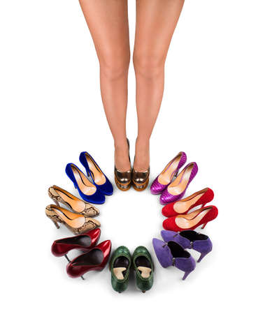 Multicolored shoes  and legs on a  white background