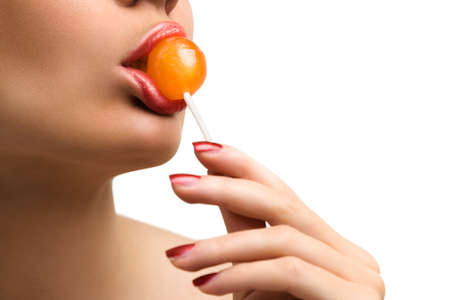 A woman sucking a lollipop on a white background photo
