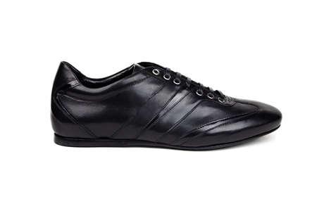 Dark male sport shoe in profile on a white background  photo