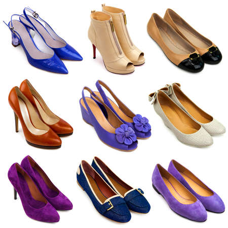 Set of different,multicolored female shoes on a white background 9 pieces