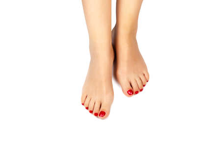 barefoot women: Female foots with an pedicure on a white background Stock Photo