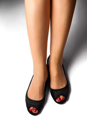 black toes: Female foot with pedicure in black shoes