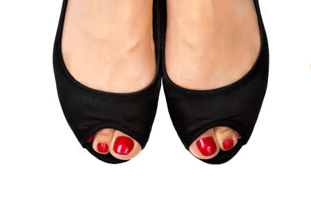 black toes: Female foot with pedicure in black shoes on a white background