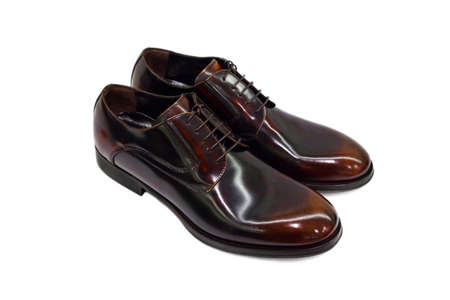 men s feet: Brown male shoes on white background