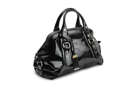 handbags: Dark female bag on white background.