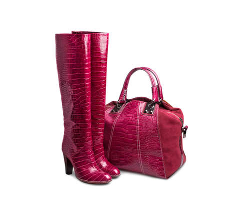 woman s bag: Red female bag boots on white background