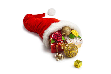 horn of plenty: Santas hat,christmas balls  and  gift boxes inside on white background