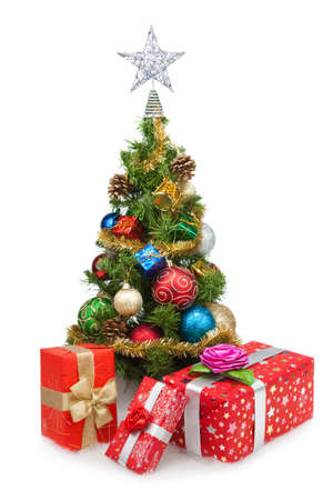 Christmas tree and gift boxes on a white background photo