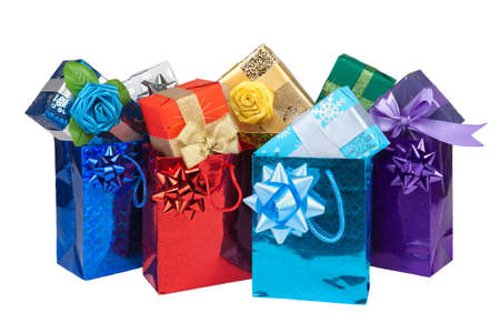 Gift boxes and bags with bow and ribbon on white background photo