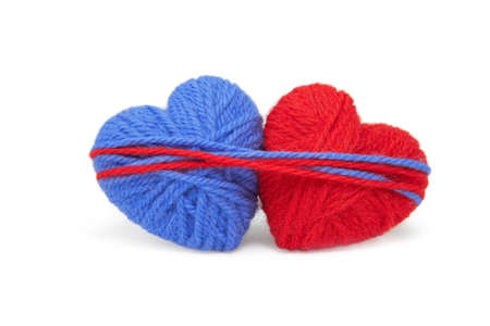 yarn: Multicolored wool hearts on white background