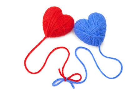 Multicolored wool hearts on white background photo