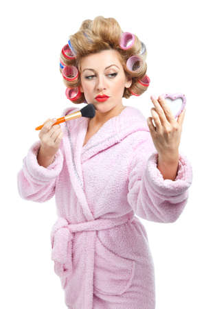 narcissism: Housewife and make up on white background