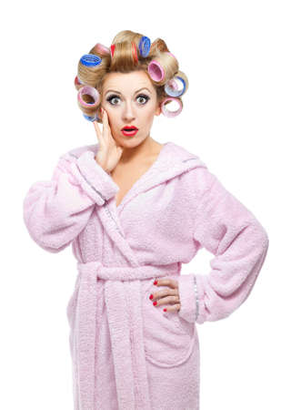 shocked face: Housewife in pink bathrobe on white background