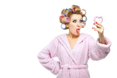 Housewife in pink bathrobe on white background photo