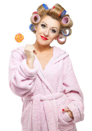 kitsch: Housewife in pink bathrobe on white background