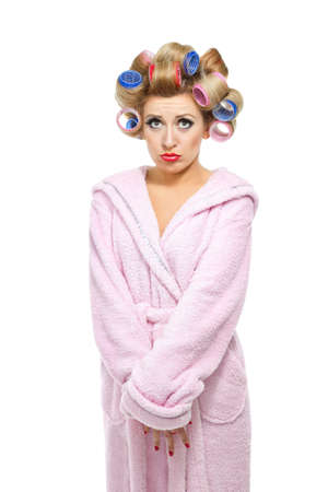 curlers: Housewife in pink bathrobe on white background