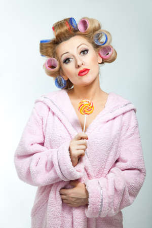 kitsch: Housewife in pink bathrobe with lollypop