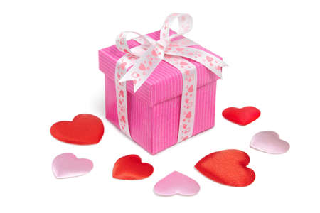 wrapped present: Hearts and gift box on white background Stock Photo