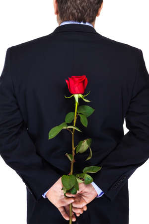 blue rose: Office clerk with red rose on white background