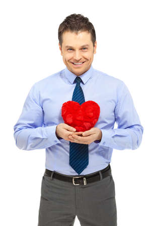 Office clerk with heartshape pillow on white background photo