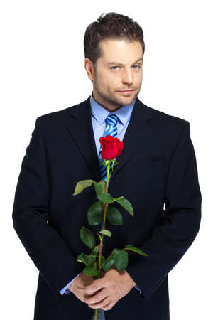 Office clerk with red rose on white background photo