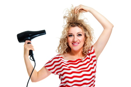 Attractive blond hair woman with hair dryer on white background Stock Photo - 18962383
