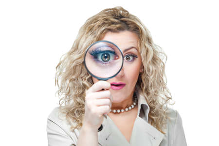 Attractive blond hair woman with magnifying glass on white background photo