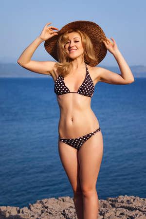 attracive: Attractive woman on a seacoast Stock Photo