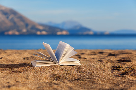 Open book on a beach