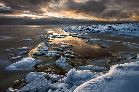 Winter seascape with dramatic sky in Russia