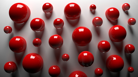 3D red shiny balls on a gray background